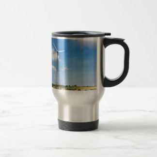 Two windmills in rural area with blue sky travel mug