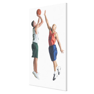 two young men dressed in opposing team gallery wrapped canvas