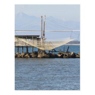 Typical italian fishing net along the river postcard