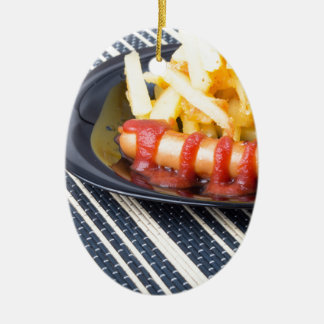 Typical Russian dish - fried potatoes and sausage Ceramic Oval Ornament