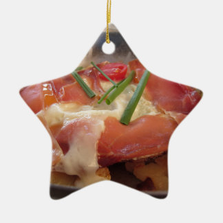 Typical South Tyrolean dish served pan fried Ceramic Star Ornament
