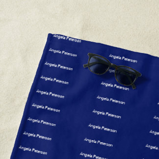 typography pattern of white names on stylish blue beach towel
