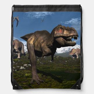 Tyrannosaurus rex attacked by triceratops dinosaur drawstring bag