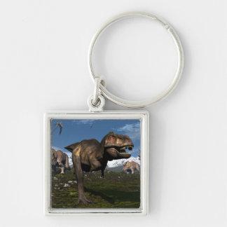 Tyrannosaurus rex attacked by triceratops dinosaur keychain