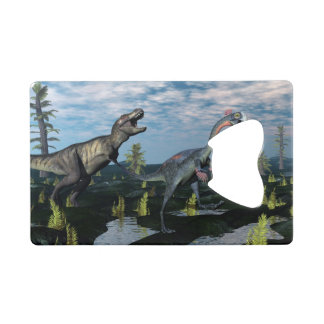 Tyrannosaurus rex attacking gigantoraptor dinosaur credit card bottle opener
