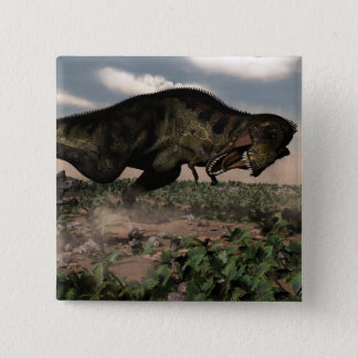 Tyrannosaurus rex roaring at a triceratops 2 inch square button