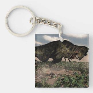 Tyrannosaurus rex roaring at a triceratops keychain
