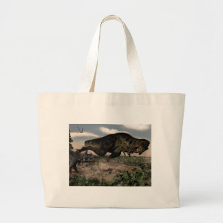 Tyrannosaurus rex roaring at a triceratops large tote bag