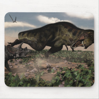 Tyrannosaurus rex roaring at a triceratops mouse pad