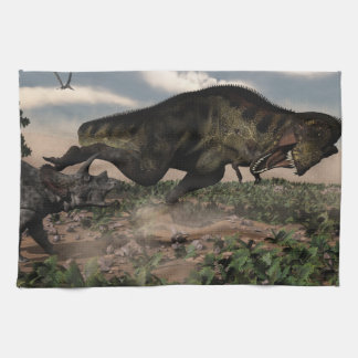 Tyrannosaurus rex roaring at a triceratops towel