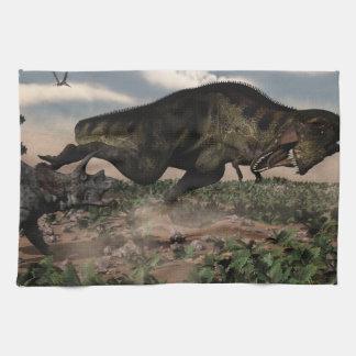 Tyrannosaurus rex roaring at a triceratops towels