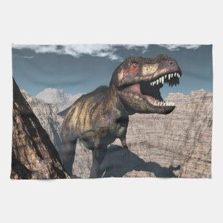 Tyrannosaurus rex roaring in a canyon kitchen towel