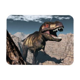 Tyrannosaurus rex roaring in a canyon magnet