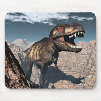 Tyrannosaurus rex roaring in a canyon mouse pad