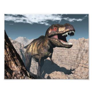 Tyrannosaurus rex roaring in a canyon photographic print