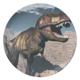Tyrannosaurus rex roaring in a canyon plate