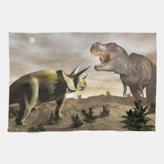 Tyrannosaurus roaring at triceratops - 3D render Hand Towels