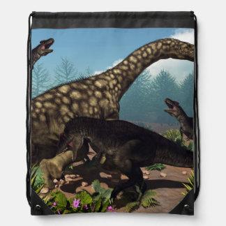 Tyrannotitan attacking an argentinosaurus dinosaur drawstring bag