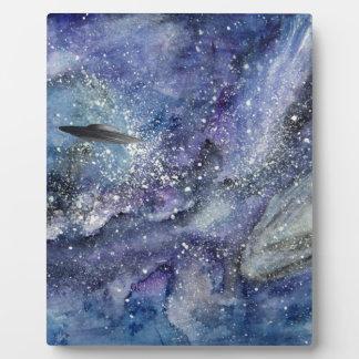 UFO spaceship in space Plaque