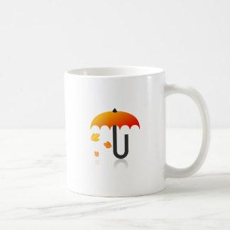 Umbrella and leaves coffee mug