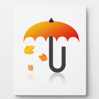 Umbrella and leaves plaque