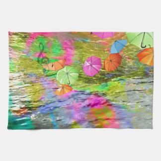 Umbrellas over sea. hand towels