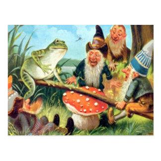 Un gnome et une grenouille sur une bascule de cham cartes postales