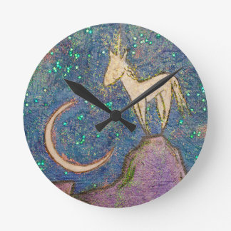 Unicorn Perched on a Mountain Looking at the Moon Round Clock