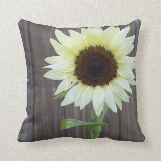 unusual white sunflower against a weathered fence throw pillow
