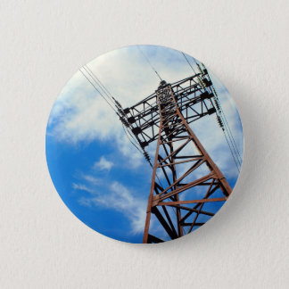 Upward view diagonally to the power line and pylon 2 inch round button