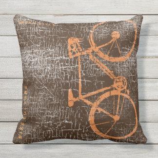 urban-style bicycle / bike on distressed brown throw pillow
