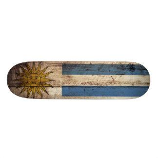 Uruguay Flag on Old Wood Grain Skate Deck