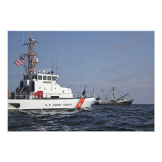 US Coast Guard Cutter Marlin patrols the waters Photo Print
