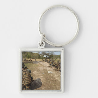 US Marines provide security as a UH-1N Key Chain