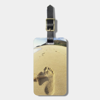USA, Hawaii, Maui, Makena Beach, Footprint and Luggage Tag