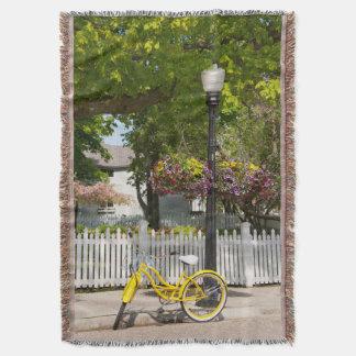 USA, Michigan, Mackinac Island. Yellow Bike Throw Blanket