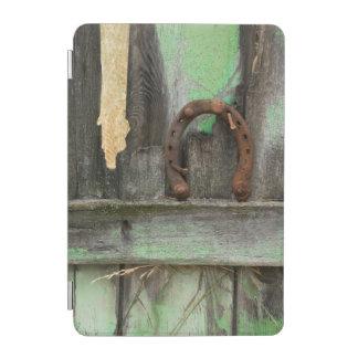 USA, Montana. Rusty horseshoe on old fence iPad Mini Cover