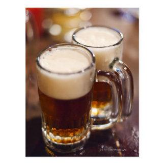 USA, New York, New York City, Two beers on bar Postcard