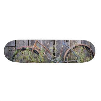 USA, Oregon, Bend. A dilapidated old bike Skateboard Decks