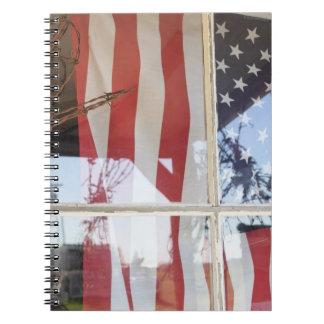USA, Oregon, Shaniko. Flag in window next to Notebook