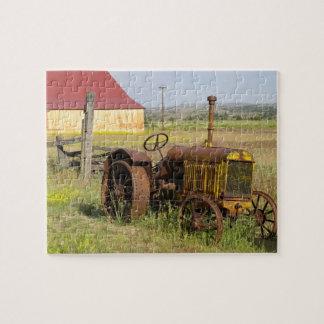 USA, Oregon, Shaniko. Rusty vintage tractor in Puzzle
