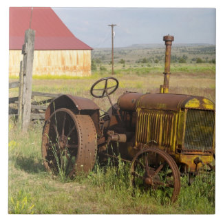 USA, Oregon, Shaniko. Rusty vintage tractor in Tile
