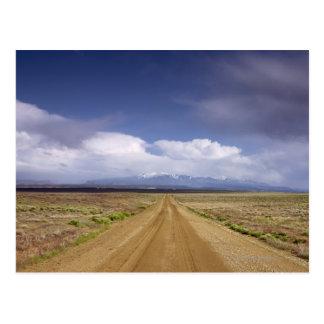 USA, Utah, Dirt road crossing landscape Postcard