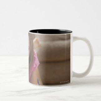 USA, Utah, Lehi, Girl (10-11) lying on rug, Two-Tone Coffee Mug
