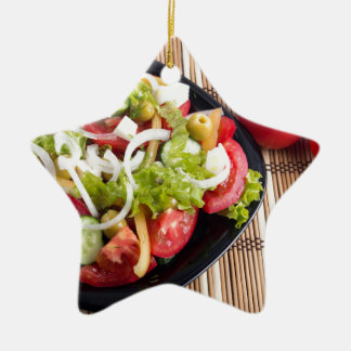 Useful and natural vegetable salad of tomato ceramic star ornament