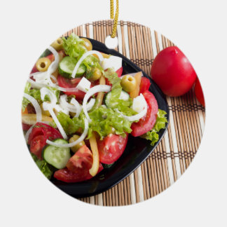 Useful and natural vegetable salad of tomato round ceramic ornament