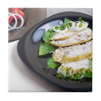 Useful and tasty homemade dinner of baked chicken ceramic tiles