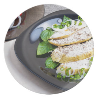 Useful and tasty homemade dinner of baked chicken dinner plates