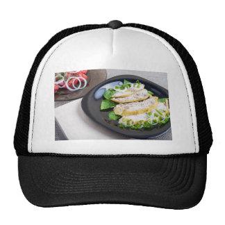 Useful and tasty homemade dinner of baked chicken trucker hat
