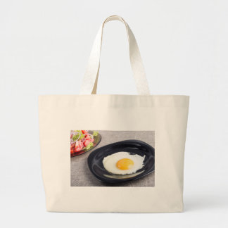Useful homemade breakfast of fried egg and a salad large tote bag